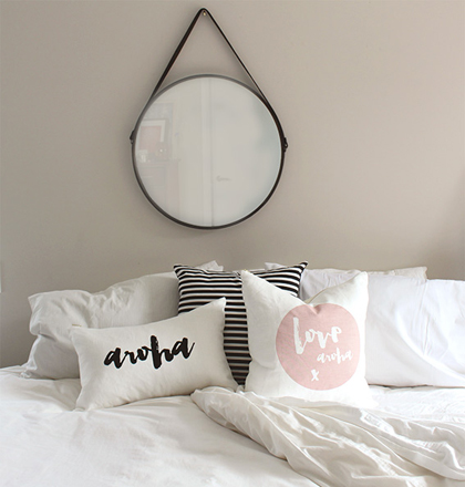 Love Aroha Linen Cushions on Bed