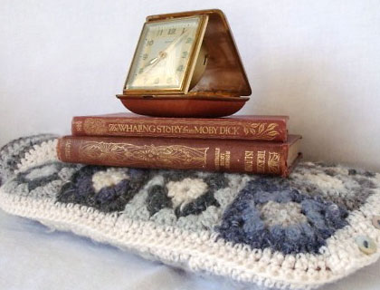 Wintery cream and grey granny square hottie cover by Alexandra Mackenzie