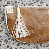 Leather and hide clutch with tassle by Bag Fever