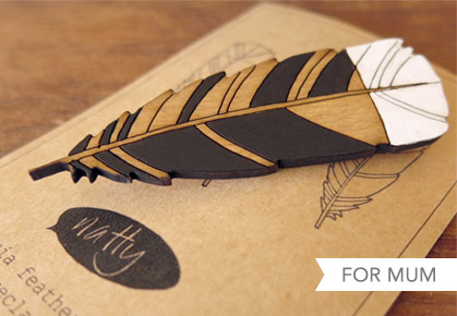 Huia feather brooch in reclaimed Rimu by I Feel Natty