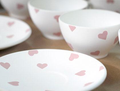 Red Heart teacups and saucers awaiting firing