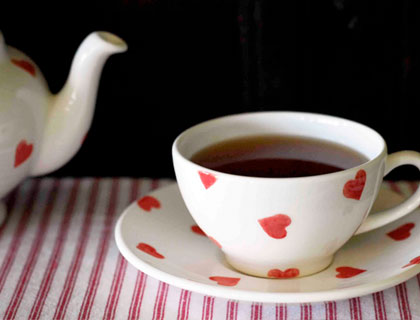 Red Heart teacup, saucer and teapot by The Little White Box