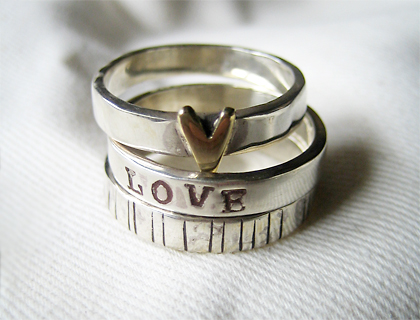 Stack of three rings with heart and etched designs by Lovebird
