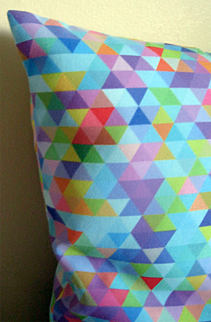 Multi-coloured Triangles Cushion Cover by Mark Catley