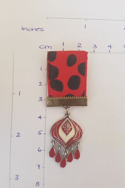 44. Steampunk rustic medal black, white and red.  Teardrop pendant/s