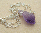 Rough Amethyst With Silver: wire-wrapped stone pendant on chain - Donated by Whiteleaf Jewellery
