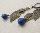 Lapis And Leaves earrings: bronze leaves on chain with blue lapis lazuli pebbles - Donated by Whiteleaf Jewellery