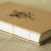 The White Rabbit Coptic Bound Journal - Donated by Honey Design