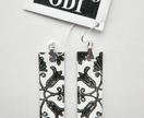 White leather earrings with black paisley design - Donated by odi-design