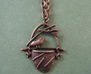 Bird in a basket necklace - Donated by one trick pony