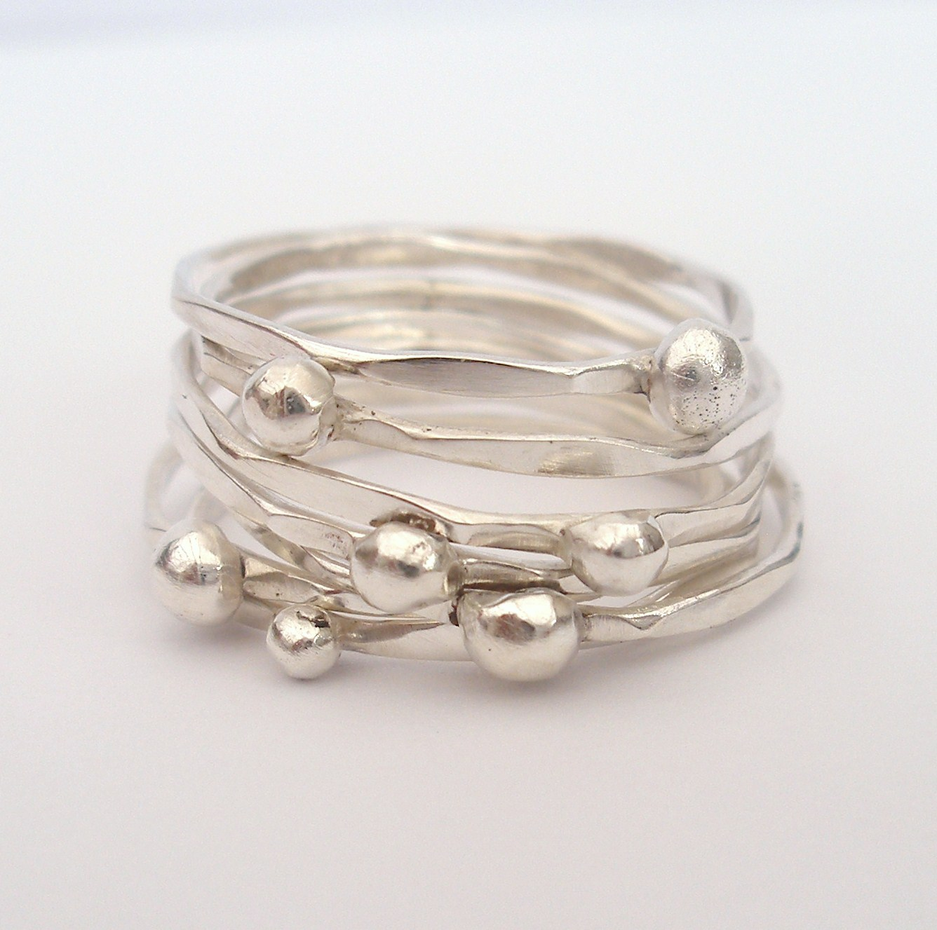7 silver stacking rings with silver balls felt