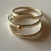 3 silver stacking rings with gold bobble