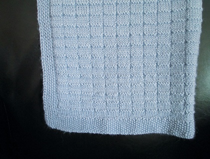 Baby's knitted blanket - pale blue