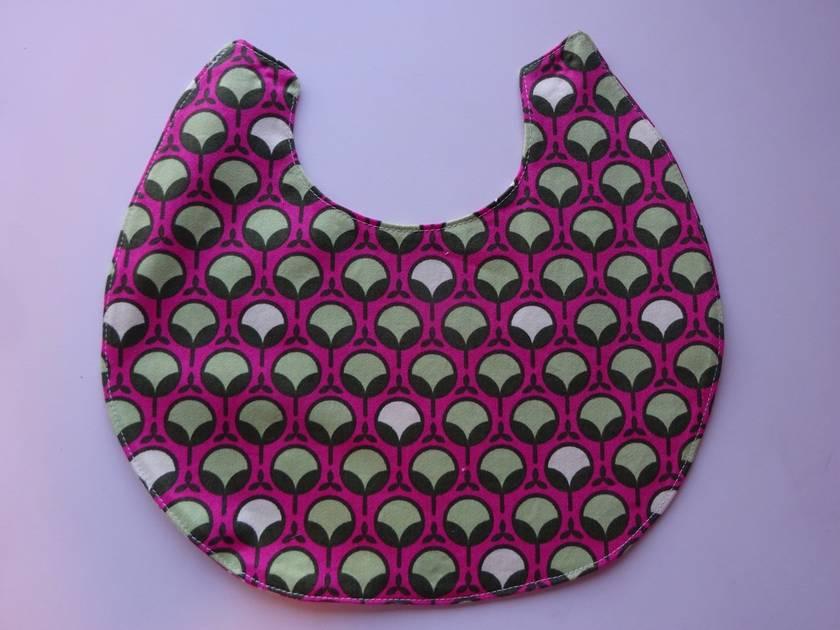Three baby bibs + a bib clip (pink and green)