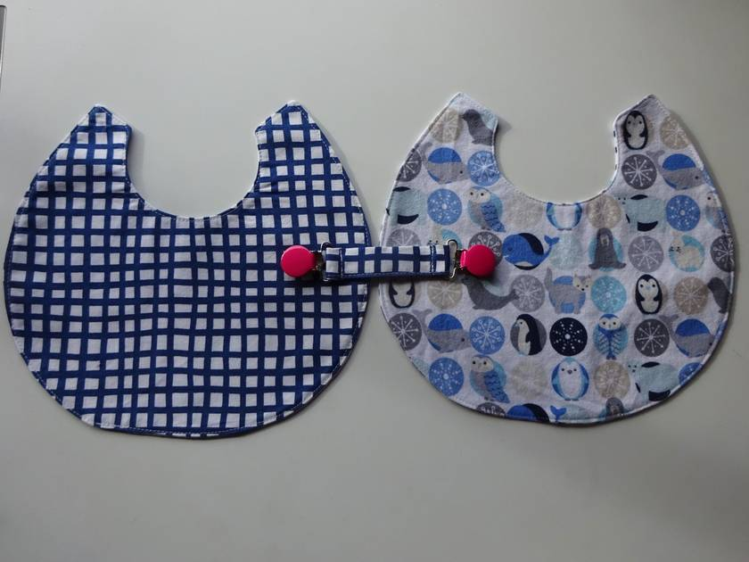 Two baby bibs + a bib clip (two sets available)