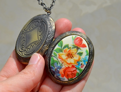 Huge locket with a vintage floral decal cabochon