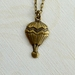 dainty brass hot air balloon charm necklace pendant
