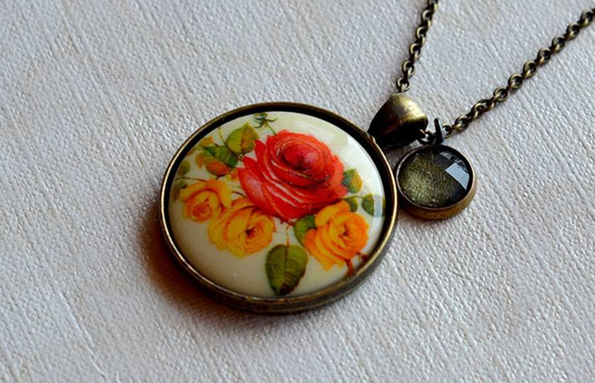 long vintage rose cameo pendant with green glass stone