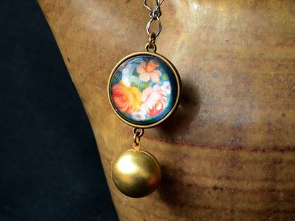 folk floral double sided globe necklace with globe locket