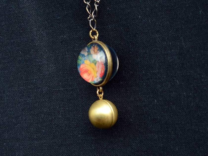 folk floral double sided globe necklace with globe locket