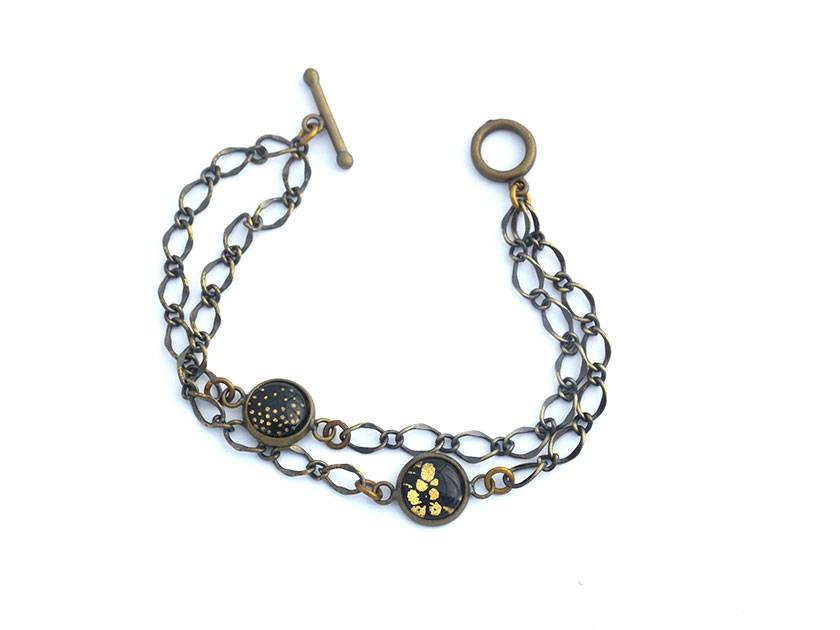 vintage style chain with two black and gold bubble charms