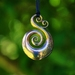 Solid Bronze Koru Pendant on cord or antique bronze chain.