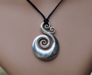 Sterling silver Koru Pendant on black adjustable cord