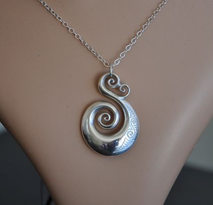 Sterling silver Koru Pendant on sterling chain.