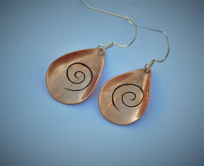 Hand crafted copper koru earrings