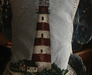 lighthouse tapestry cushion with feather inner