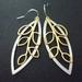 Beautiful matte gold leafy branch with matte silver earrings