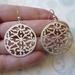 Oriental inspired cut work round earrings - silver