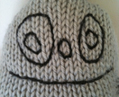 Give us a hug - Knitted monster in grey merino
