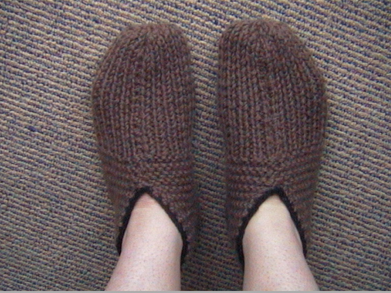 lovely old-fashioned pair of knitted slippers. Make them ...