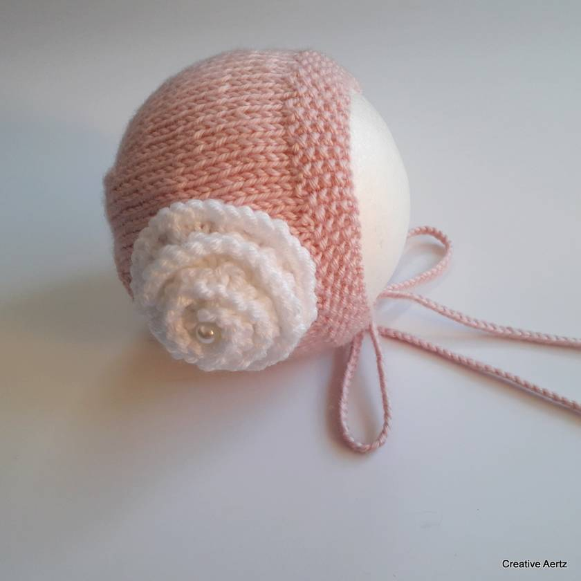 Soft Pink Handknitted Bonnet with White Rose - Newborn