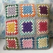 Granny Square Cushion Cover, crochet granny squares multicoloured with grey background and white highlight