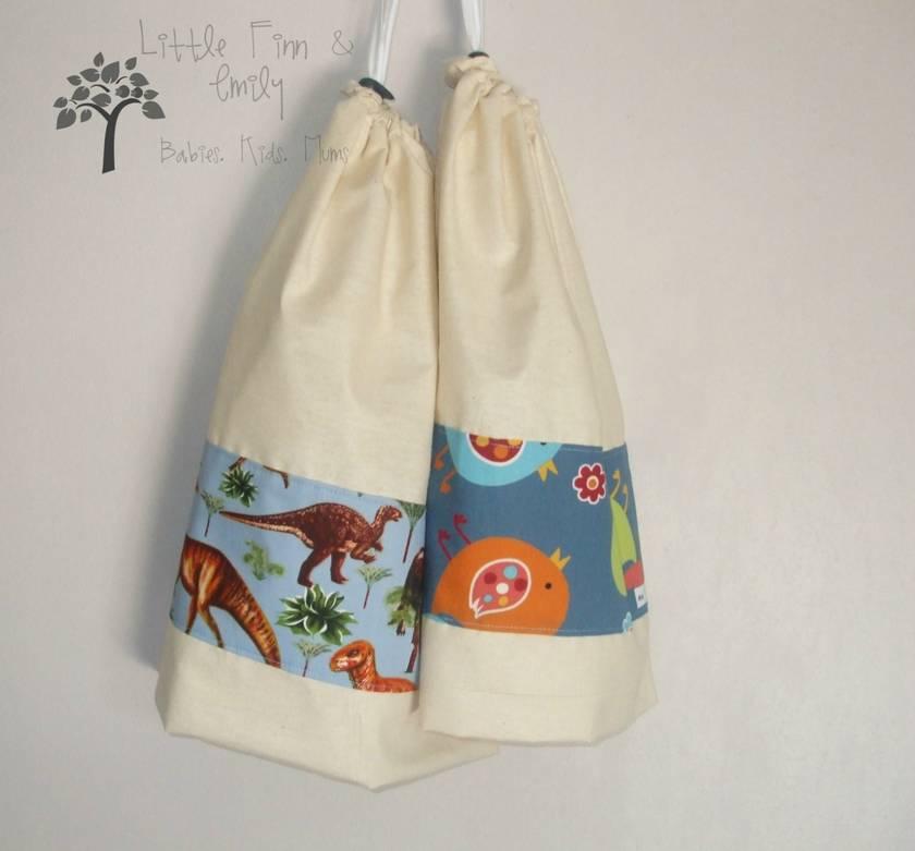 Calico Take-along bag with fun dinosaur panel.