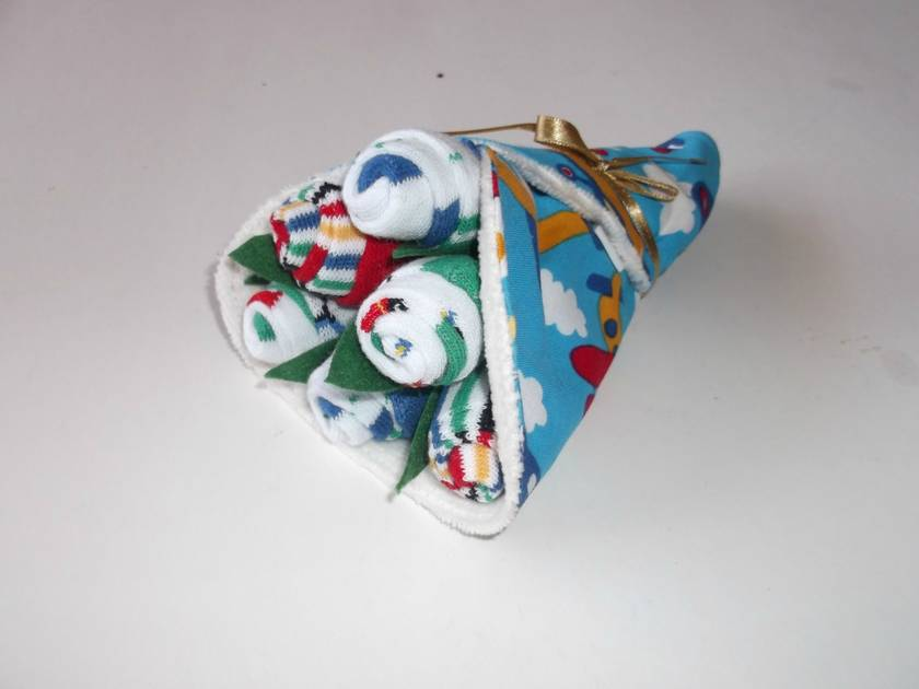 Baby girl Bouquet -- Half a dozen rosebuds and a co-ordinating bib.  Great baby shower gift.