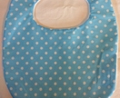 Light blue bib with white polka dots