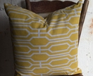 Yellow and white geometrical cushion