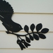 Fantail on Kowhai feature