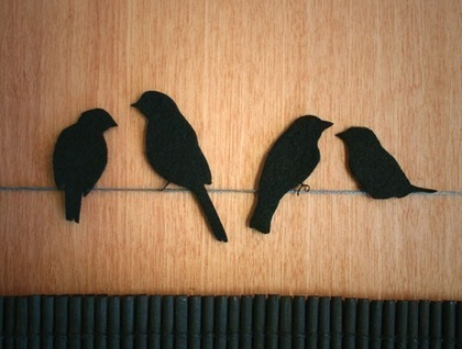 Black felt birds 'sittin' on a wire'
