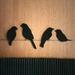 Black felt birds 'sittin' on a wire'