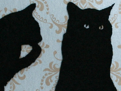 3 felt cats