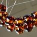 6 Tortoiseshell effect smaller round beads.