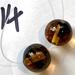 A pair of Tortoiseshell effect smaller round beads.