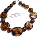 Tortoiseshell effect large flat beads and spacer beads.