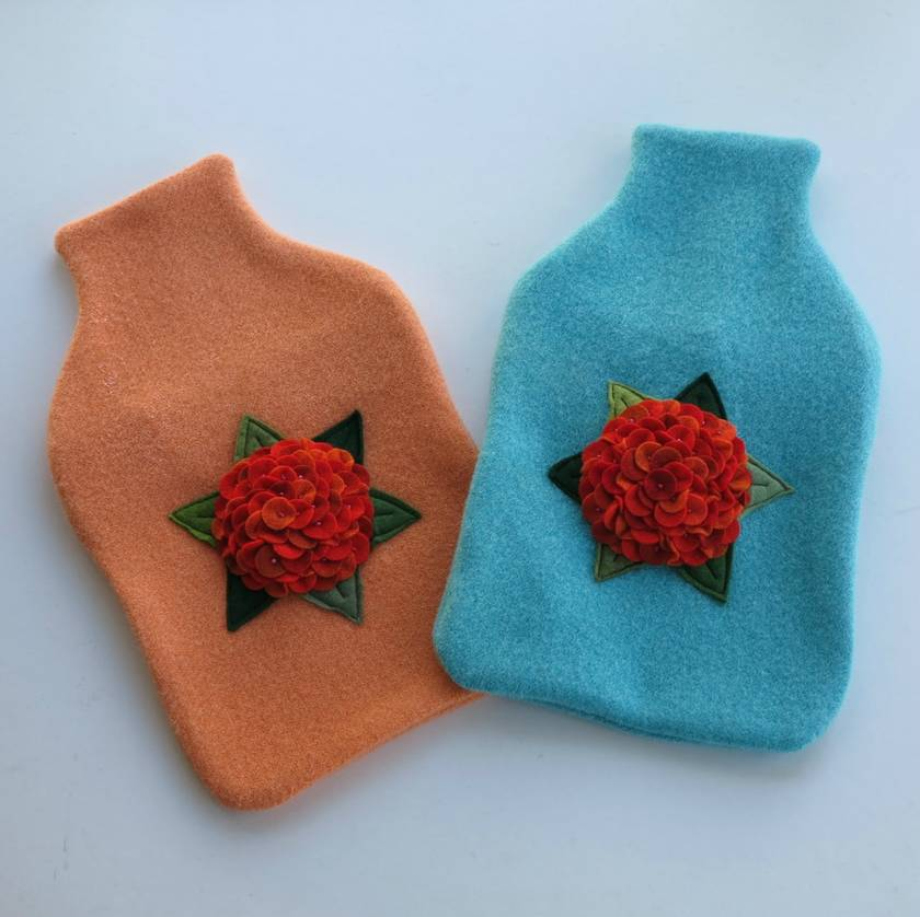 "Hotwater Bottle Cover "" Hydrangea shades of orange"" on either turquoise or melon."
