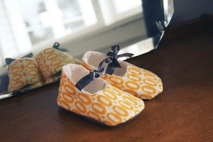 Little yellow baby shoes