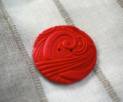 Large handmade button.
